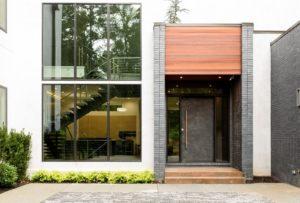 Home with a modern steel door installation by Scardino Doors.