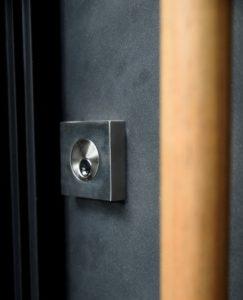 Close-up of the beautiful hardware on Scardino Door's modern pivot-hinge door installation.