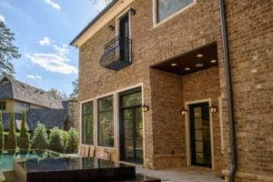 Custom door and balcony installation on a Sandy Springs home