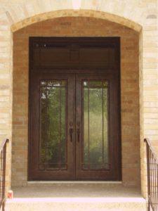 Wrought iron door for brick home
